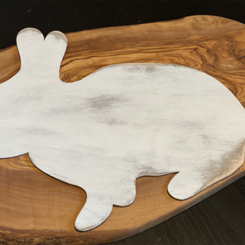 wood cut shaped bunny painted white and distressed with a brown