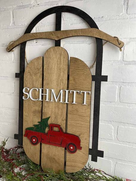 Wood Sled door hanger with either name and monogram or red truck, green tree with name