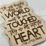 wood engraved Little Prince quote